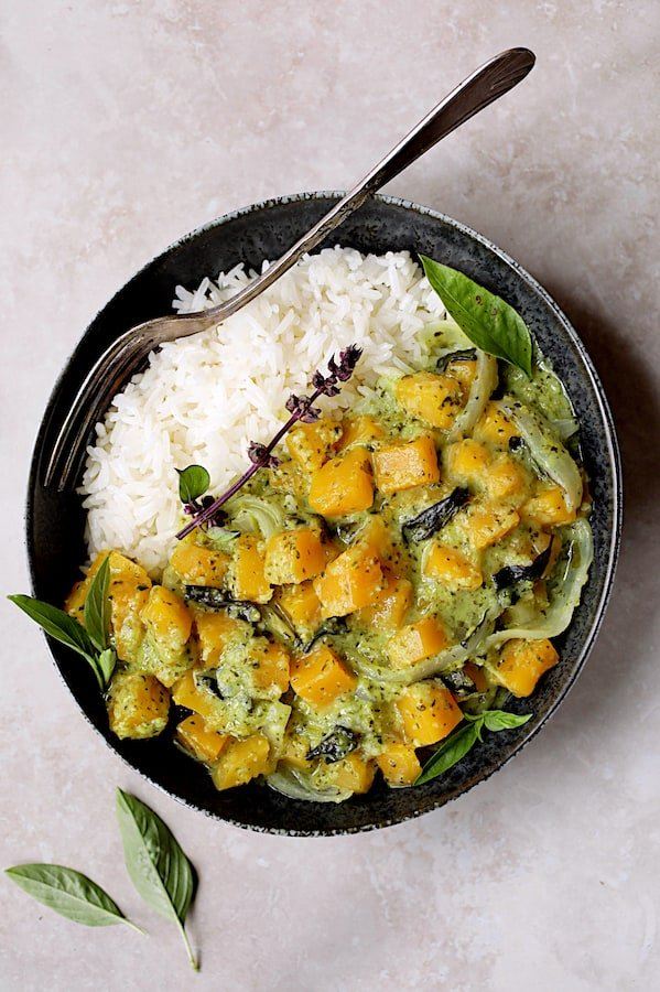 Butternut Squash in Fresh Green Curry - Overhead shot in black bowl garnished with Thai basil