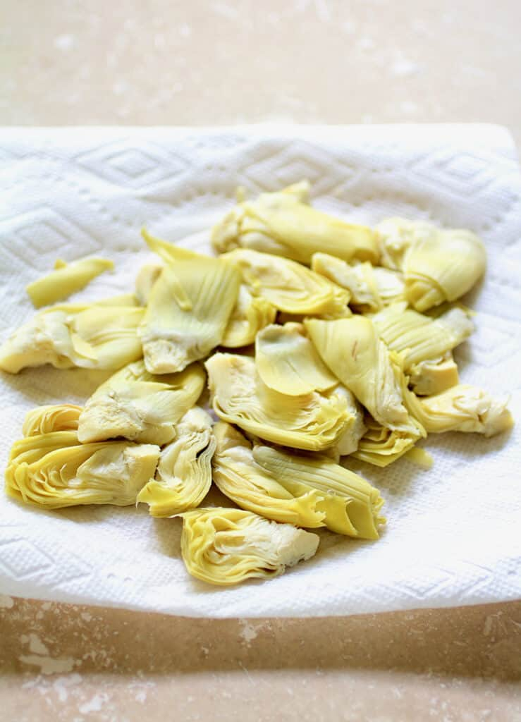 Close-up shot of artichokes being dried on paper towel
