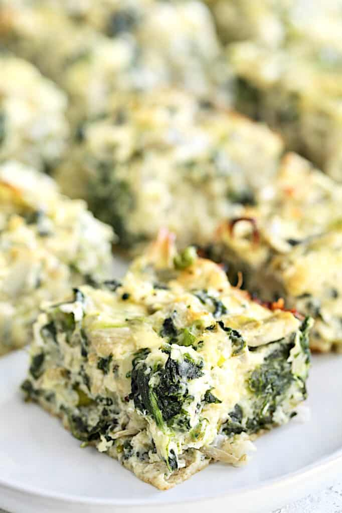 Spinach Artichoke Squares - Close-up shot of one of the squares