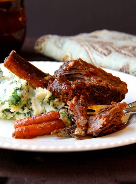 Stout Braised Beef Short Ribs and Colcannon - Short rib and colcannon on white plate with carrots