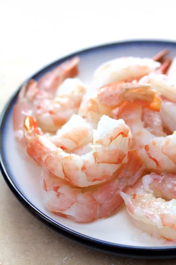 Fresh, raw wild-caught shrimp on plate