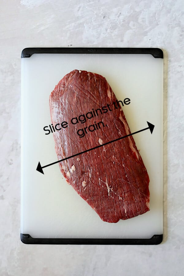 Photo showing how to slice a flank steak agains the grain.