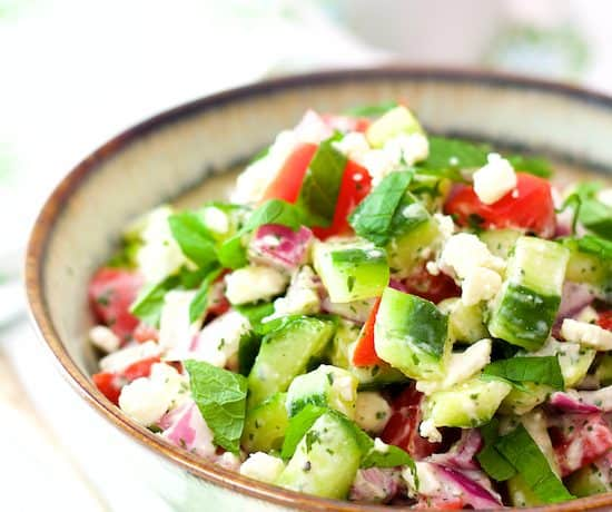 Cucumber Tomato and Red Onion Salad with Yogurt - Mint Dressing and Feta Cheese