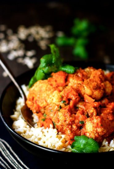 You won't miss the meat! Cauliflower and Sweet Potatoes in Roasted Red Pepper Mole is a lively, vegetarian Mexican-inspired dish!
