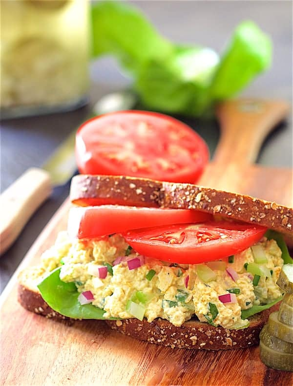 Photo of Curried Tofu Salad on whole grain bread with lettuce and tomato.