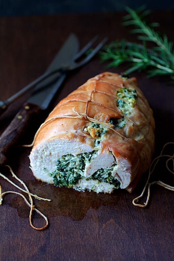 Spinach and Ricotta Stuffed Turkey Breast with Garlic Herb Sauce - Straight-on close-up shot of interior of stuffed turkey breast