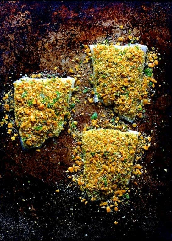 Photo of Curried Chickpea Encrusted Fish on baking sheet.