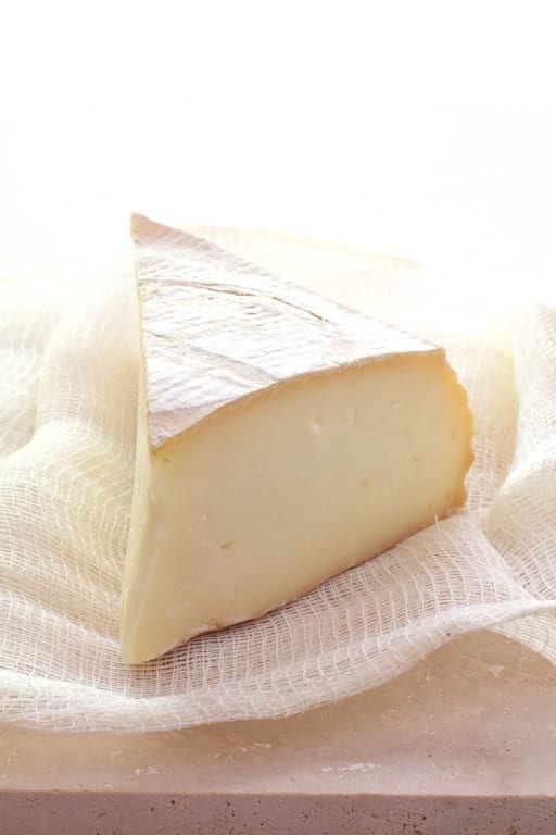Wedge of Taleggio cheese on cheesecloth