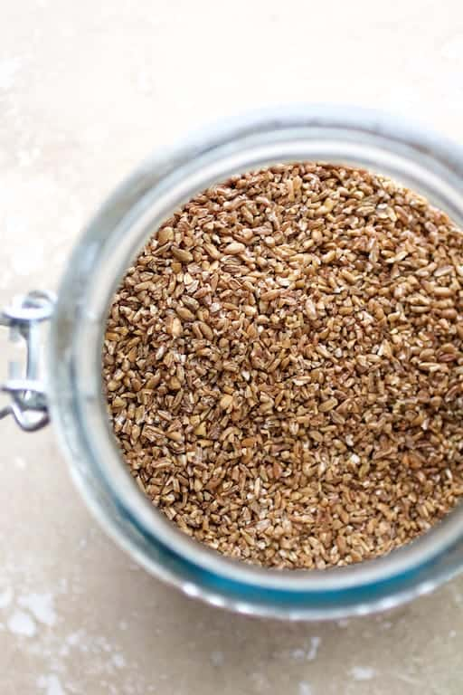Photo of bulgur wheat in glass jar.