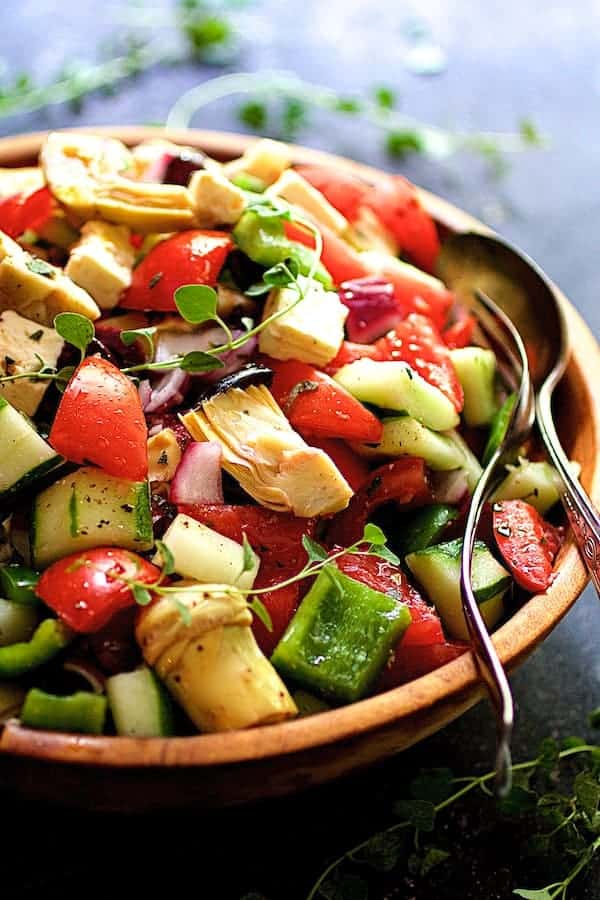 Greek Vegetable Salad with Marinated Feta Cheese - Close-up shot of salad in wood bowl