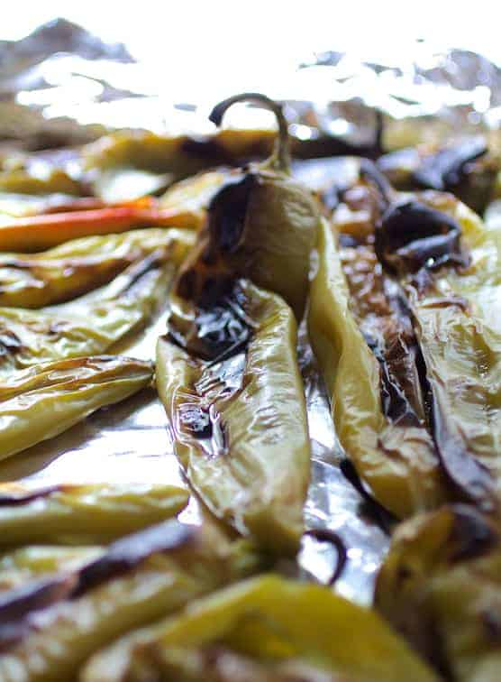 Photo of roasted Hatch green chiles on baking sheet.