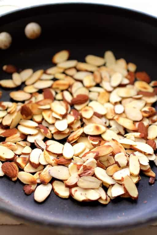 Toasted almonds in nonstick skillet