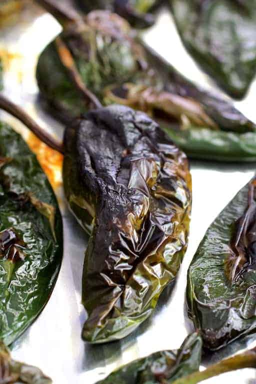 Roasted Poblano peppers before being peeled