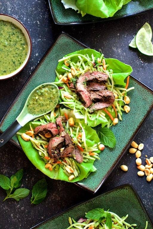Thai Beef Lettuce Wraps with Mint Dressing and Vegetable Slaw - Overhead hero shot on green square plates
