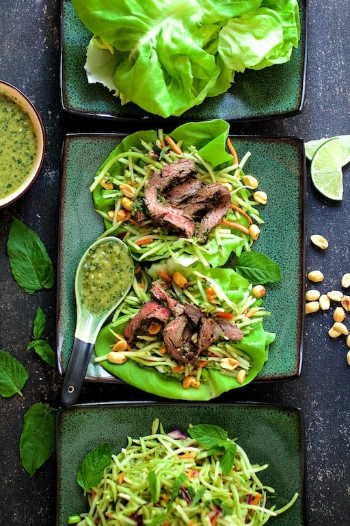 Thai Beef Lettuce Wraps with Mint Dressing and Vegetable Slaw - Another overhead shot of the dish on green square plates