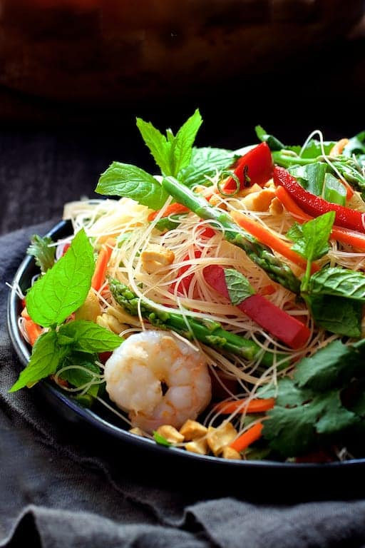 Vietnamese Spring Roll Salad - Hero shot of salad on black plate garnished with mint sprigs