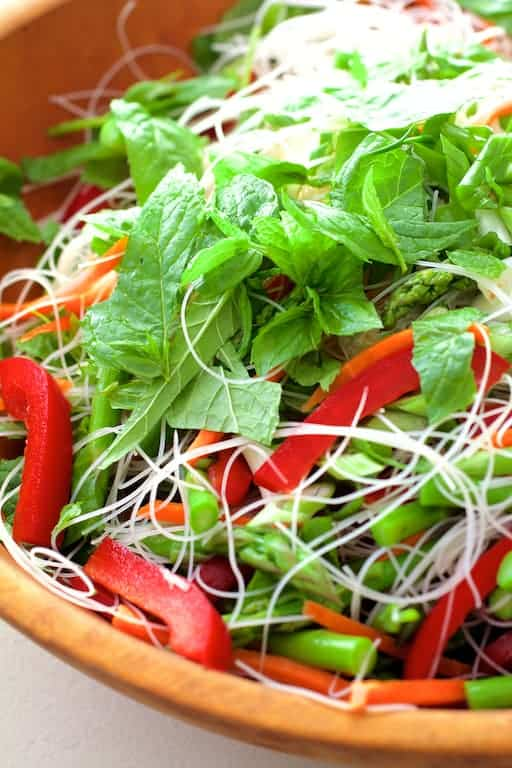 Vietnamese Spring Roll Salad - Close-up of salad in wooden bowl with chopped mint on the top