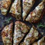 Naan Potato Pizza with Radish Pesto and Smoked Mozzarella cut into eight slices.