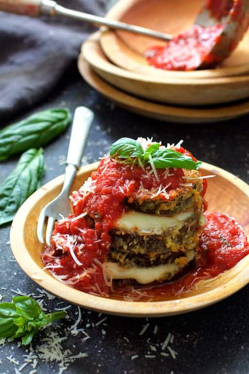 Eggplant Parmesan Stacks - In wooden bowl after being sauced and garnished with fresh basil