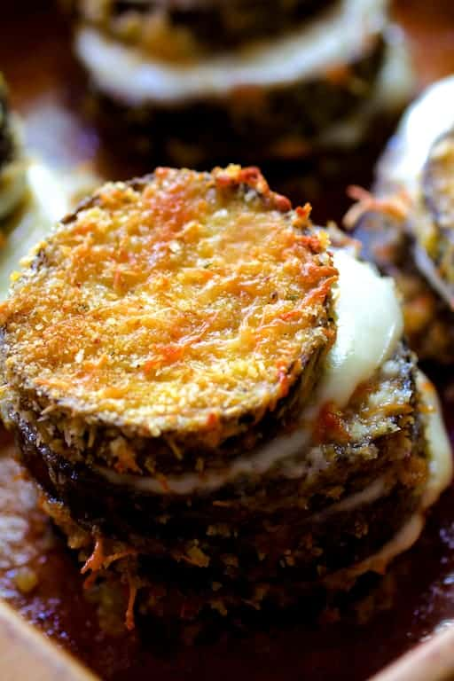 Eggplant Parmesan Stacks - Close-up shot of one of the stacks with melty cheese between the layers