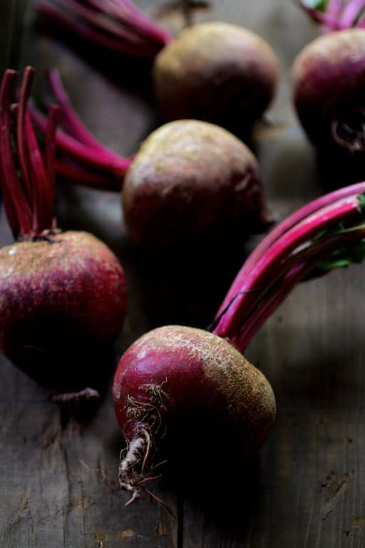 Photo of fresh, raw, uncooked red beets.