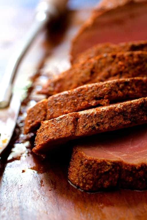 Spice Rubbed Pork Tenderloin with Peach Chipotle Barbecue Sauce - Close-up photo of cooked, sliced pork tenderloin