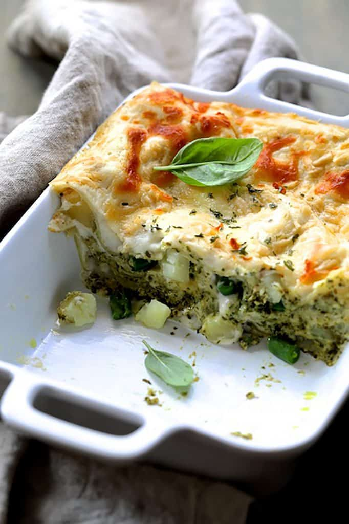 Lasagna with Pesto Green Beans and Potatoes - Pan of lasagna cut into showing the layers of pasta, potatoes ad green beans