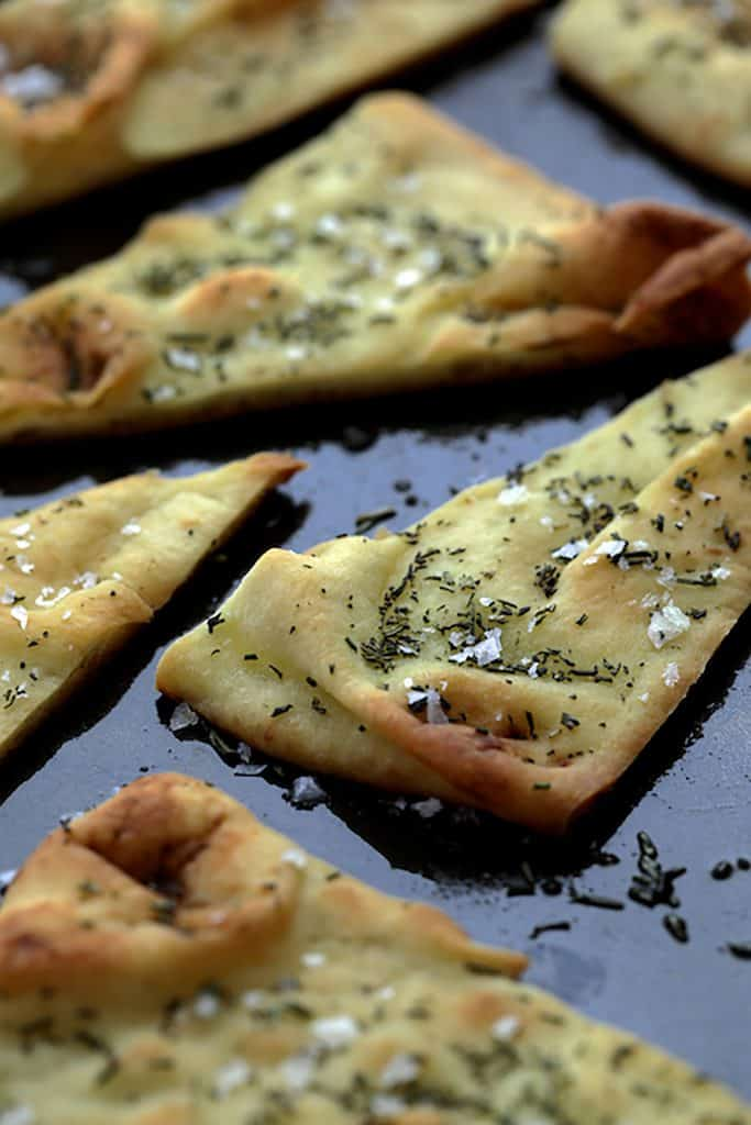 White Bean Artichoke Spread with Rosemary Sea Salt Flatbread Chips - Photo showing baked flatbread chips