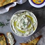 White Bean Artichoke Spread with Rosemary Sea Salt Flatbread Chips - Overhead shot of white bean artichoke spread with flatbread chips and Nancy's Cottage Cheese