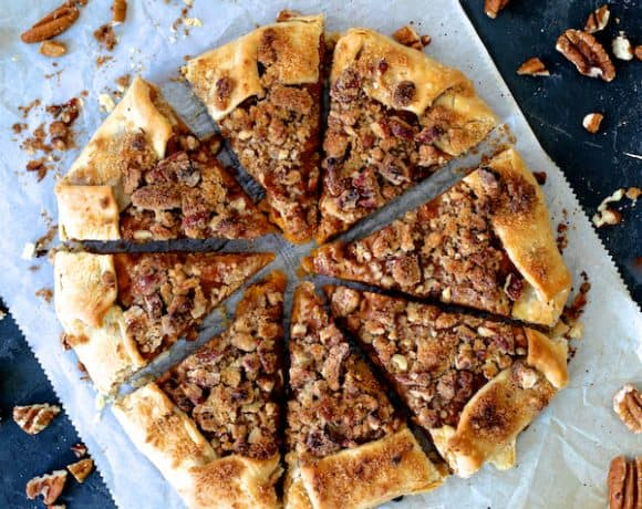 Sweet Potato Galette with Pecan Streusel Topping top down shot on parchment paper sliced