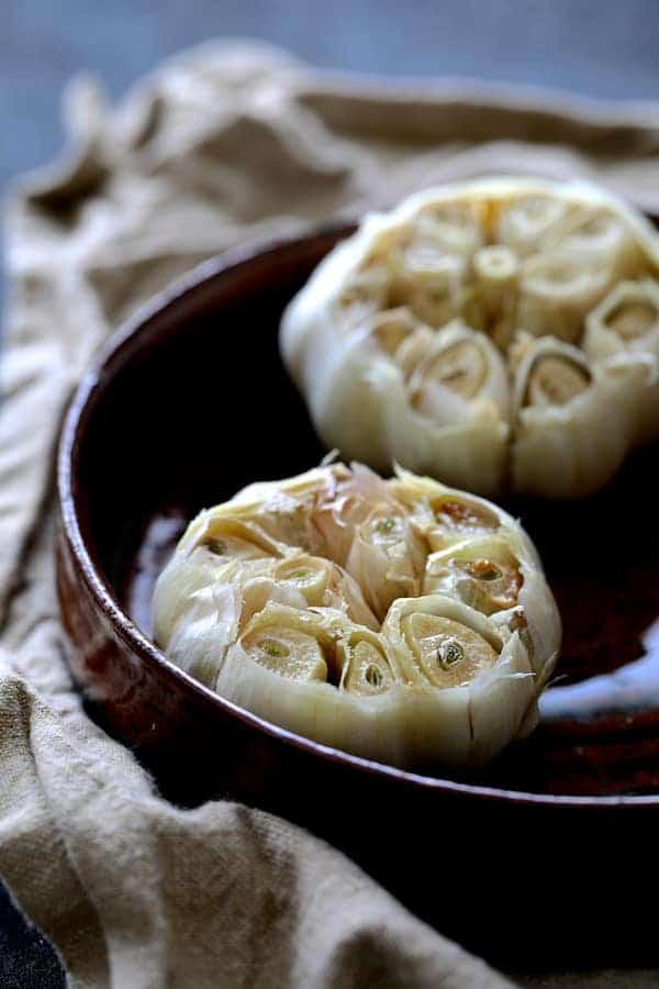 Creamy White Bean Rutabaga and Roasted Garlic Soup with Quinoa Parmesan Crisps - Photo of roasted garlic