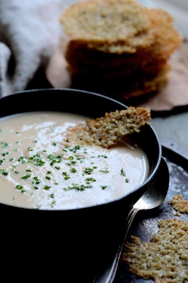 Creamy White Bean Rutabaga and Roasted Garlic Soup with Quinoa Parmesan Crisps