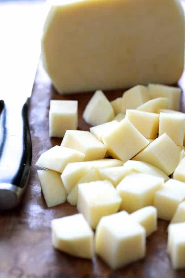 Creamy White Bean Rutabaga and Roasted Garlic Soup with Quinoa Parmesan Crisps - Photo of peeled and cubed rutabaga