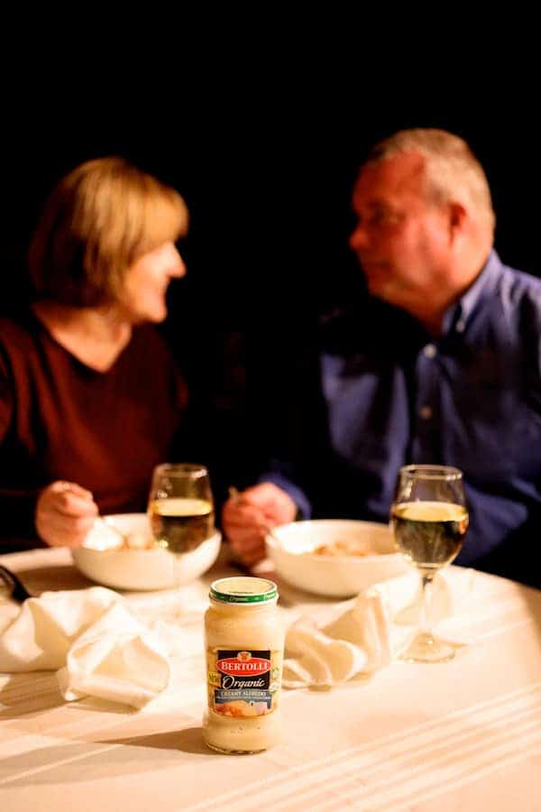 Seared Sea Scallops with Spicy Bacon and Sun Dried Tomato Alfredo Sauce [Bertolli) - Photo of couple enjoying this dinner