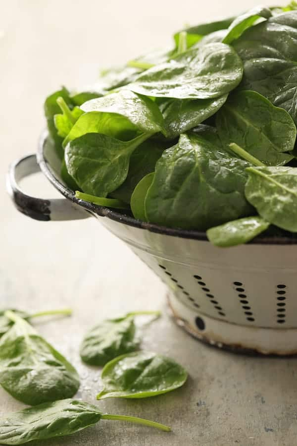 Spinach Parmesan Ranch Twice Baked Potatoes - Photo of fresh spinach in white colander