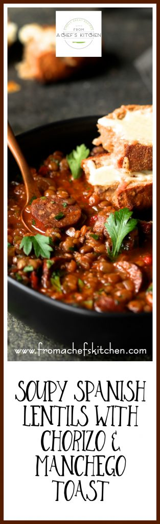 Soupy Spanish Lentils with Chorizo and Manchego Toast will have you not minding winter! Braised lentils with spicy chorizo sausage kicked up with red wine and Spanish spices and served with crusty bread topped with melted Manchego cheese is perfect winter comfort food!