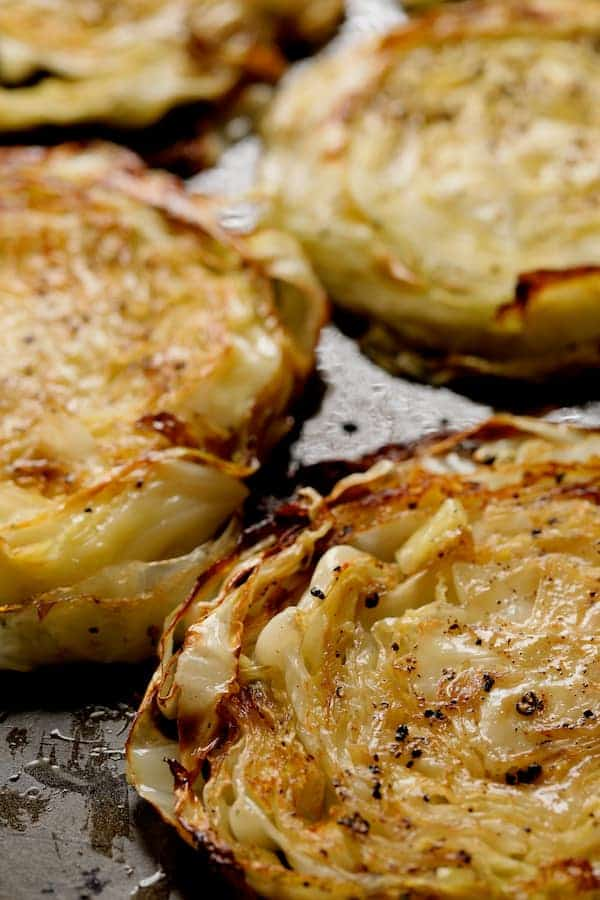 Roasted Cabbage Steaks with Mustard Vinaigrette Close-up on baking sheet