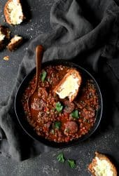 Soupy Spanish Lentils with Chorizo and Manchego Toast overhead shot with gray napkin