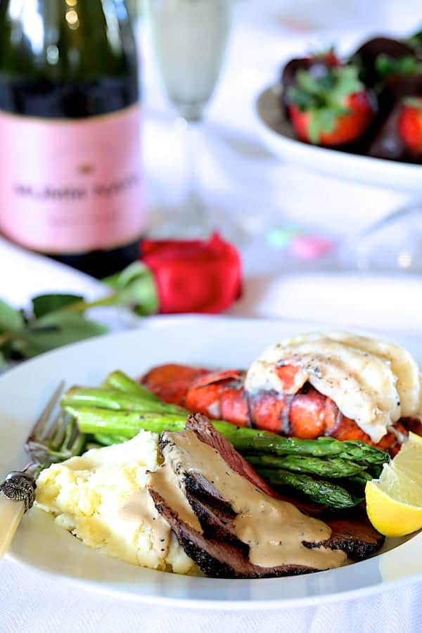 Steak au Poivre and Broiled Lobster Tail - On white serving plate with asparagus