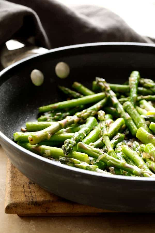 Asparagus Prosciutto and Fontina Tortino - Sauteed asparagus for the tortino in skillet