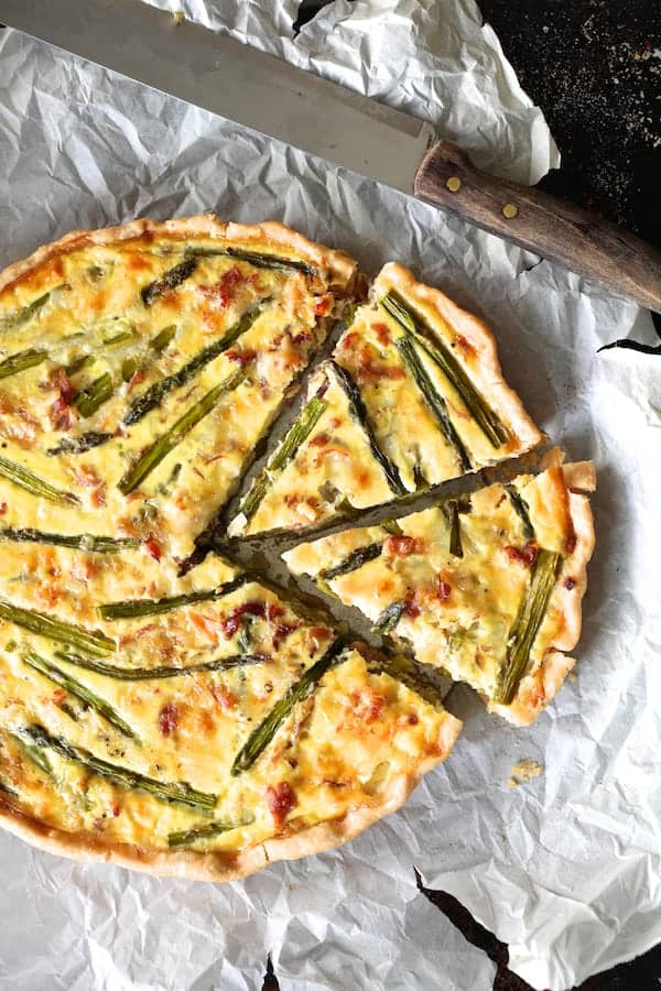 Asparagus Prosciutto and Fontina Tortino - Overhead shot on parchment paper with knife sliced
