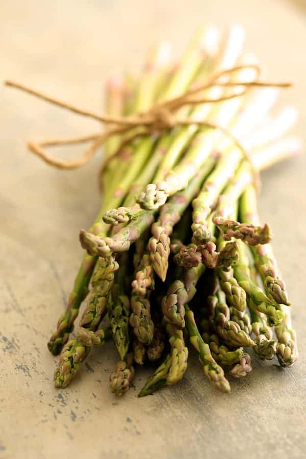 Asparagus Prosciutto and Fontina Tortino - Bunch of fresh asparagus tied with twine