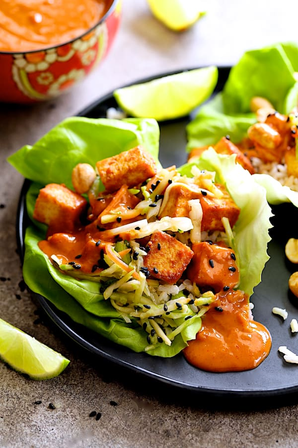 Vegan Korean Tofu Lettuce Wraps with Tahini Gochujang Sauce and Spicy Slaw - Close-up shot of finished dish