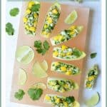 Crab Mango and Avocado Salad with Chile Lime Dressing in Endive is a flavor explosion! It's the perfect appetizer to make all spring and summer long! #crab #avocado #mango #lime #appetizer #progressiveeats