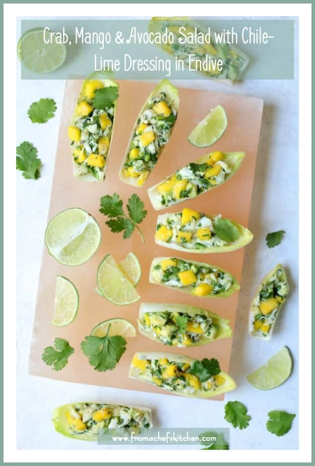 Crab Mango and Avocado Salad with Chile-Lime Dressing in Endive is a flavor explosion! It's the perfect appetizer to make all spring and summer long!  #crab #avocado #mango #lime #appetizer #progressiveeats