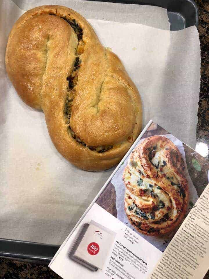 Photo of baked bread with a photo the recipe.