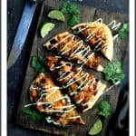 Chipotle Chicken, Sweet Potato and Black Bean Flatbread Pizzas with Avocado Sour Cream are spicy, healthy-ish and delicious! It's how to get yourMexican food fix and pizza fix in one!