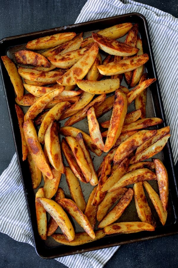 Photo of cooked oven fries on baking sheet.