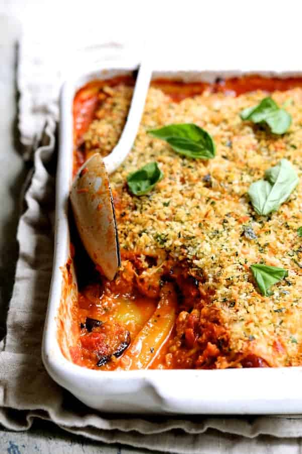 Photo of Italian Summer Vegetable Casserole with a large spoonful removed from casserole.