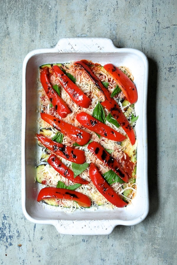 Photo of second layer of casserole with grilled red pepper.